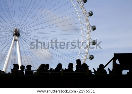 bus full of tourists watching the london eye - stock photo