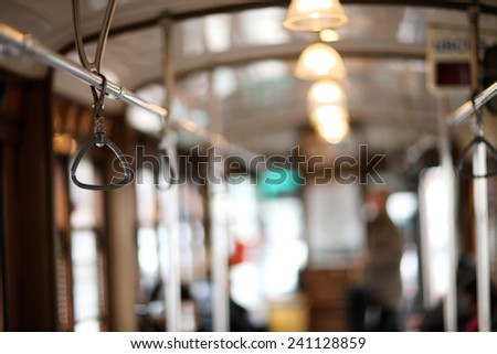 Bus hand-rail for standing passengers  - stock photo