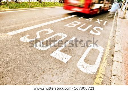 Bus in bus lane - stock photo