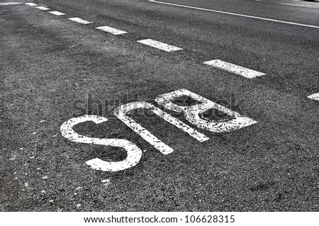 Bus lane sign painted on tarmac road