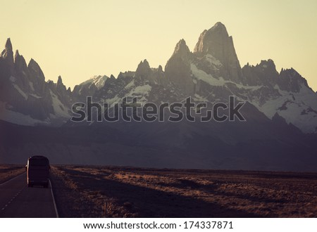 Bus on the road towards Fitz Roy Range in Argentina  - stock photo