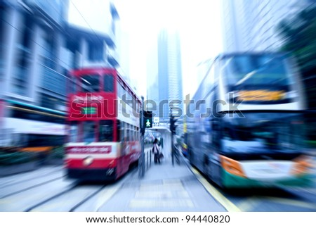 bus rushing on the street in motion blur - stock photo