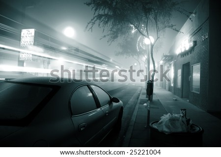 Bus speeding through foggy night street. West Hollywood, California. - stock photo