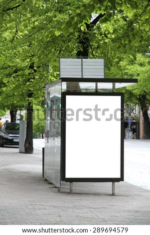 Bus station with blank billboard  - stock photo
