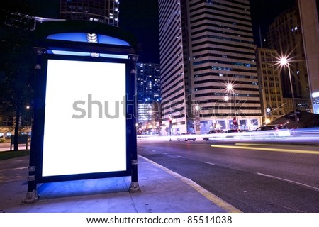Bus Stop Ad Display - Backlite Advertising Display on the Bus Stop in Downtown Chicago. - stock photo