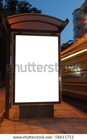 Bus stop at night. Blurred light from the passing vehicles are visible. This is for advertisers to place ad copy samples on a bus shelter. - stock photo