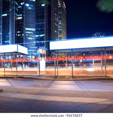 bus stop at night in beijing - stock photo
