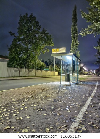 Bus stop at night time - stock photo