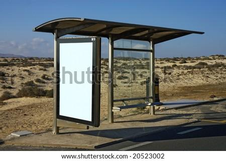 bus stop in desert - stock photo