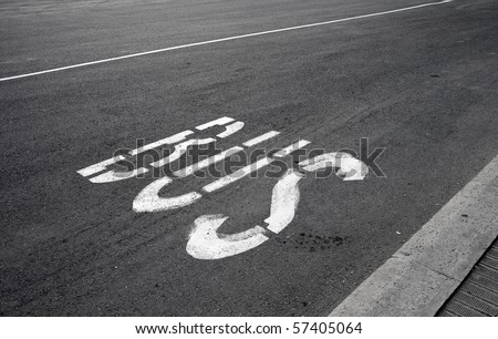Bus stop label on the asphalt road - stock photo