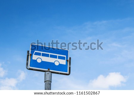 stock-photo-bus-stop-sign-against-blue-s