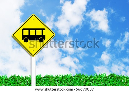 bus stop sign on beautiful sky and grass field background - stock photo