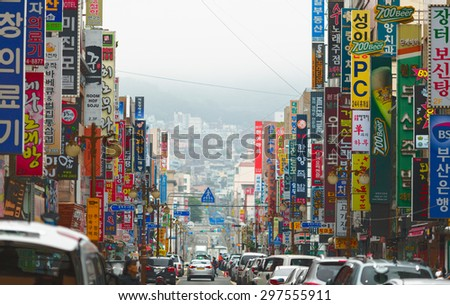 BUSAN CITY, SOUTH KOREA - 18 MAY 2013: Jung-Gu Street with colorful commercial signboards across the whole street. Busan city, South Korea - stock photo