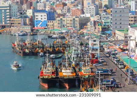 BUSAN, KOREA - OCTOBER 27, 2014 : Fishing ships at dock near the Jagalchi Fish Market in Busan, Korea. - stock photo