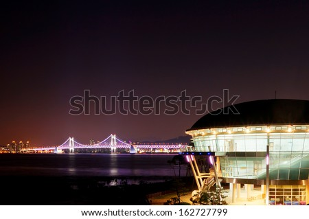 BUSAN - OCT 25: Night view of Gwangan Bridge and Nurimaru APEC House on October 25, 2013 in Busan, South Korea. It has been used as a memorial hall and a prestigious international conference hall. - stock photo