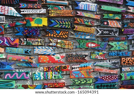 BUSAN - OCT 26: The Culture Garden series of painted wooden fish in Gamcheon Village on October 26, 2013 in Busan, South Korea. It is a joint project by artists Jin Young-sub and Park Kyung-seok.  - stock photo