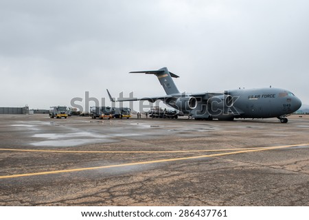 Busan, South Korea - 28 February 2012:  A C-17 Globemaster is getting refueled by fuel trucks.