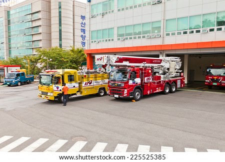 BUSAN, SOUTH KOREA - SEPTEMBER 26, 2014: Fire-fighting vehicles near fire-station in Busan town, Republic of Korea - stock photo