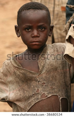 BUSANZA, KISORO, UGANDA  - NOV 2 : An unidentified refugee from Democratic Republic of Congo at the border village of Busanza November 2, 2008 in Kisoro, Uganda. - stock photo