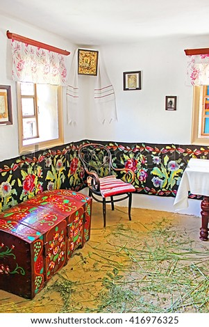 "BUSHA, UKRAINE- JULY 28, 2012: Interior of typical Ukrainian house at Historical and Cultural Reserve ""Busha"", Vinnytsia region, village Busha, Ukraine. The interior in the style of the Cossacks"