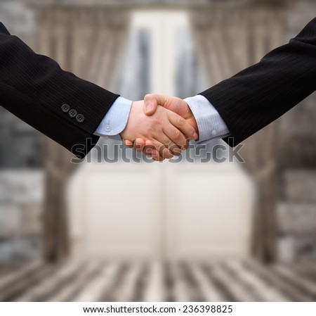 busines man handshake with modern interior background  - stock photo