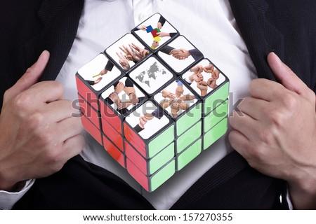 Businesman open inside shirt for show Six color cube puzzle  - stock photo