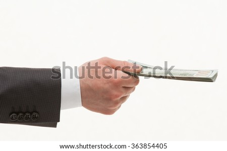Businesman's hand holding dollars, white background - stock photo