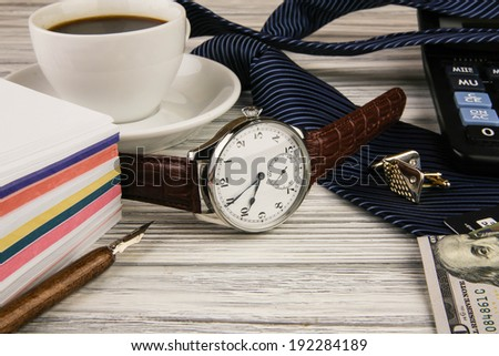 Business a still life with use of expensive watch - stock photo