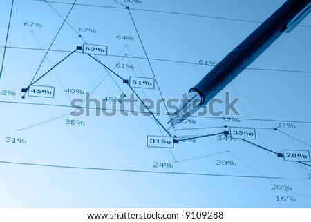 Business accessories on a background of diagrams. - stock photo