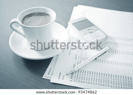 Business accessories with blue tint - Coffee break - stock photo