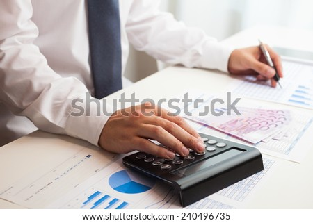 Business accountant checking documents - stock photo