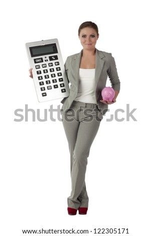 Business accountant holding giant calculator and piggy bank over a white background - stock photo