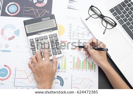 Delightful Business Accountant With Document Graph Financial And Calculator On Office  Table. Concept Planning Budget And