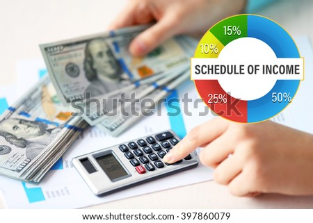 Business accounting concept.  Woman counting money and working on  calculator at the table - stock photo