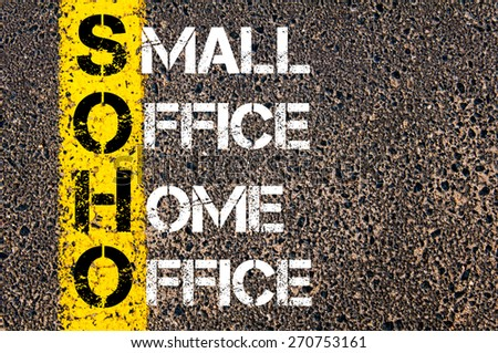 Business Acronym SOHO as Small Office Home Office. Yellow paint line on the road against asphalt background. Conceptual image - stock photo