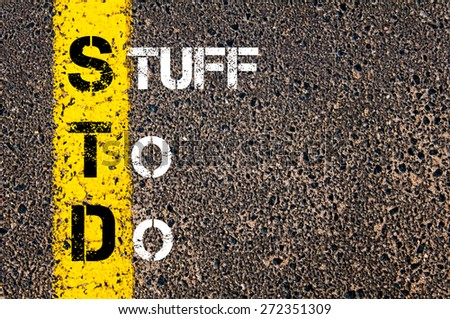 Business Acronym STD as STUFF TO DO. Yellow paint line on the road against asphalt background. Conceptual image - stock photo