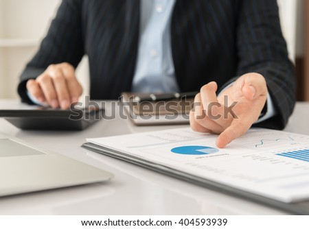 Business adviser analyze financial numbers to view the performance of the company or analysis return on the investment. - stock photo