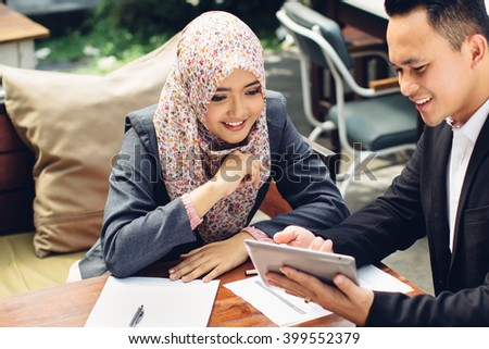 Business adviser analyzing financial figures of the company while meeting