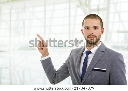 business an in a suit pointing with his finger, at the office - stock photo