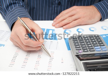 Business analysis - calculator, sheet, graph, (business report) and analyst.