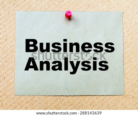 Business Analysis written on paper note pinned with red thumbtack on wooden board. Business conceptual Image - stock photo