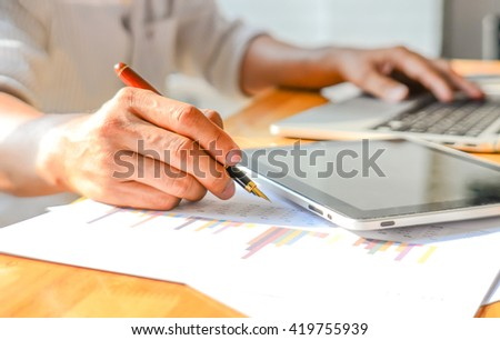 Business Analyst graph , Analysts graph in office , Performance analysis chart.Blur images and poor light background. - stock photo