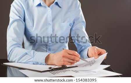 Business analyst working with data, grey background - stock photo