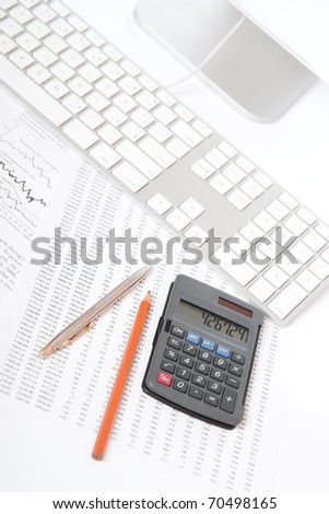 Business analyst workplace - pencil, pen, sheet with numbers, graph, keyboard, part of computer and calculator - stock photo