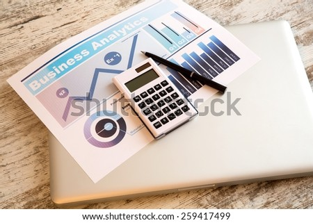 Business analytics in the office on a wooden desk.  - stock photo
