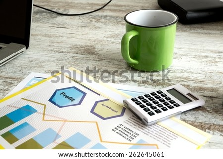 Business analytics with a Data sheet and a cup of coffee. - stock photo