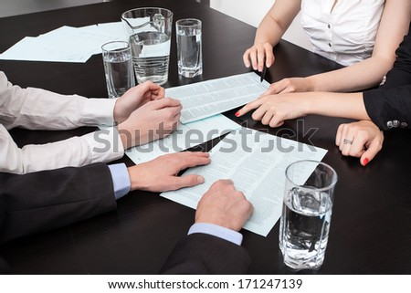 Business analyze at a meeting, four people