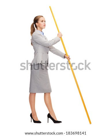 business and advertisement concept - calm woman holding flagpole with imaginary flag - stock photo