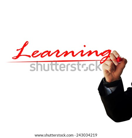 "Business and advertisement concept. Close up of businessman writing ""Learning"""