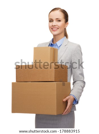 business and delivery service concept - smiling businesswoman holding cardboard boxes - stock photo